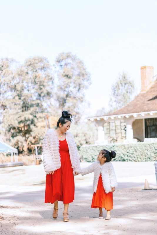 mommy and me, target style, mommy and me twinning, red dresses, holiday outfits, fur coats, orange county lifestyle photography